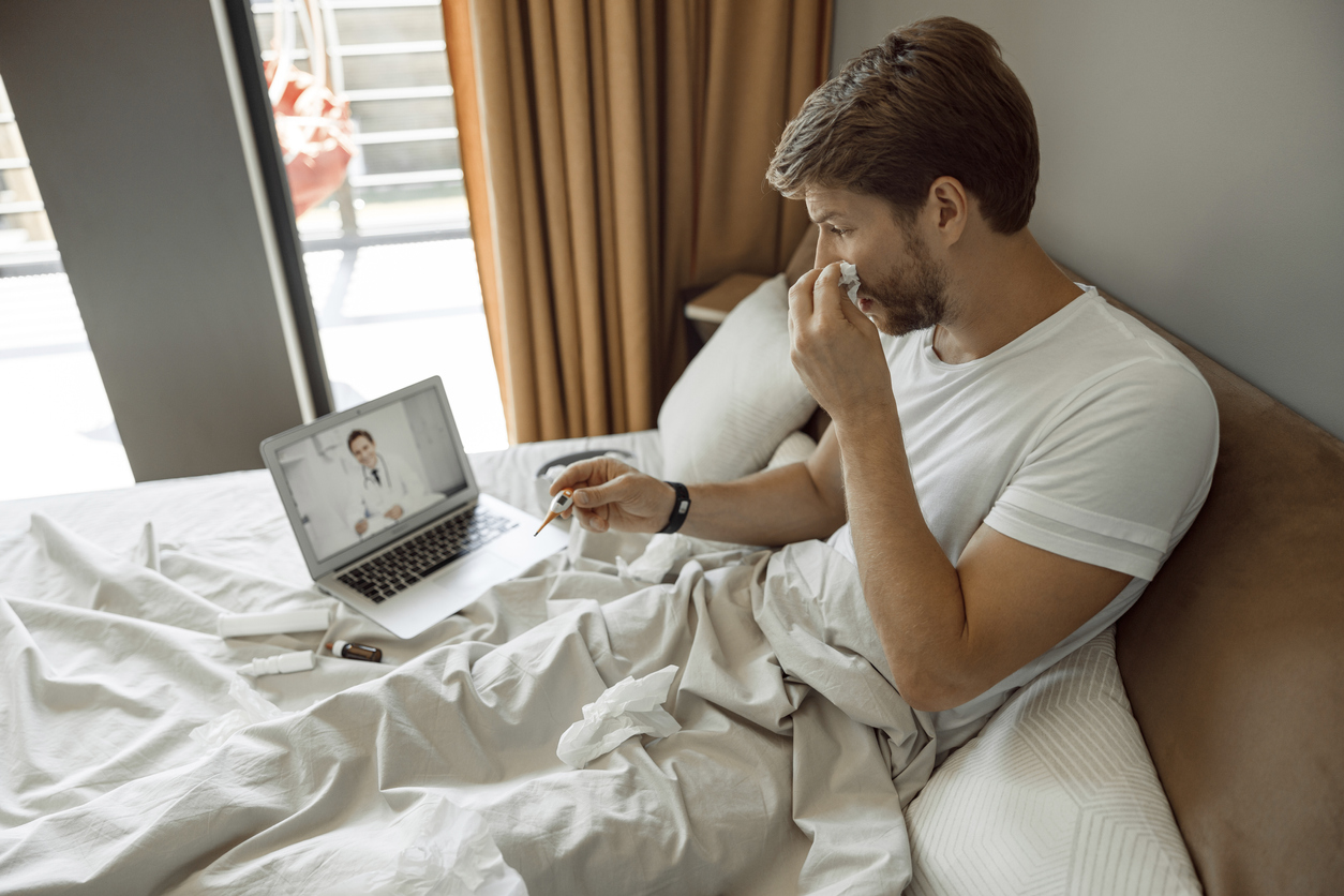 Man sick with COVID-19 receiving telemedicine