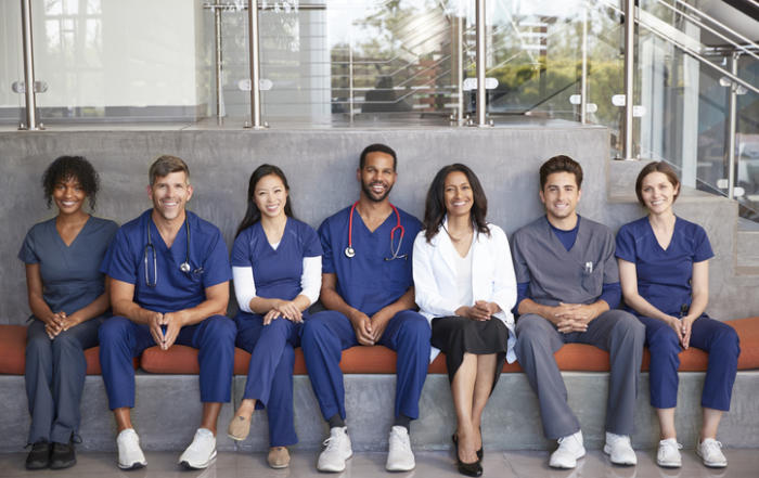 Group of doctors showing variations of what doctors wear daily.