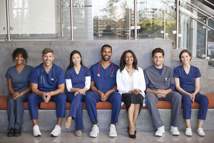 A group of physicians showing what a doctor wears to work each day.