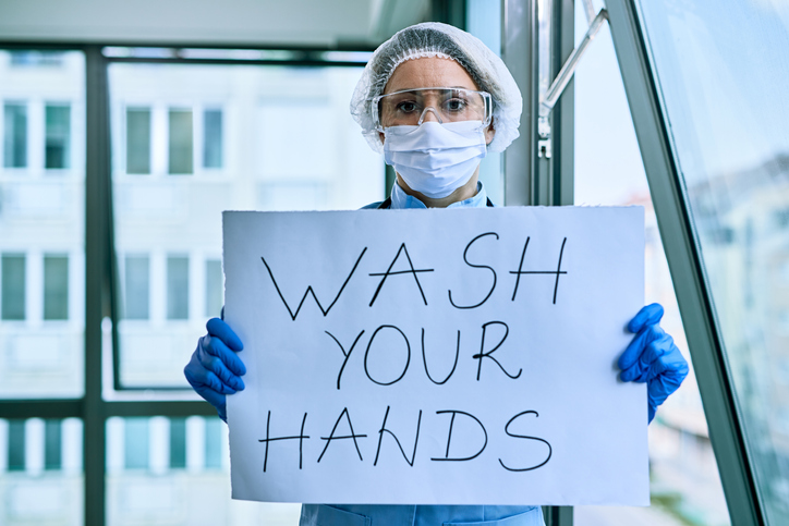 Nurse celebrating World Hygiene Day by encouraging hand hygiene