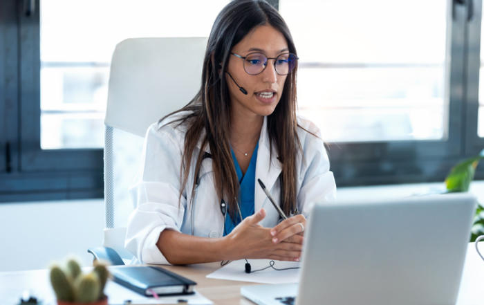 Physician connecting with a patient via telehealth.